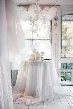 Shabby chic cottage with pumpkins, chandelier & a pretty vintage style screen door