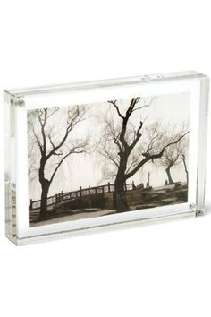 """We love the Original Magnet Frame, by Canetti! It is made of two thick panels of clear, solid acrylic which are held together by tiny magnet points. Place your picture between them and whoa!..expert framing without all the hardware. Float your photos in the center of the frame for a cool acrylic border. BEST FEATURE:  Put two pictures back to back for """"2-frames-in-1""""! Can be displayed either vertically or horizontally. Measures 8""""W x 10""""L x 1.5""""H. Clean with a soft cloth. Do not use any…"""