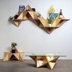 T.Shelf: a triangular, multifunctional modular storage system. With it, you can make a shelf, table, bookcase, and so on.