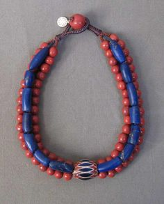 by Miranda Crimp   Early 20th century African chevron bead is combined with 19th century Afghani lapis and 13th-14th century or earlier Chinese teracotta beads