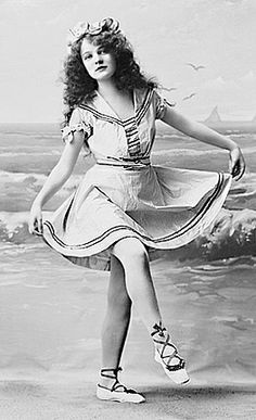 1910 girl by the seashore in bathing suit
