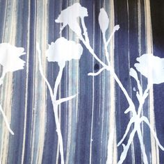 Shades of blue done with disperse dye and screen printed by hand with white carnation print