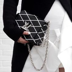 black and white quilted chain shoulder bag