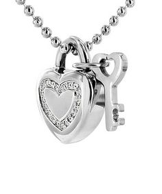 Even the smallest touch of jewelry is a bountiful piece of treasure that brings out a woman's radiance. Adorned around the neck, this stainless steel necklace combines a shiny finish with a heart-shaped lock-and-key pendant to capture style and sweetness.