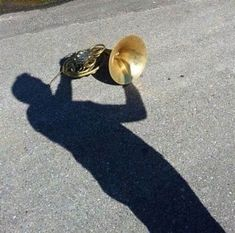 He used to be a great French horn player...now he's just a shadow of himself!