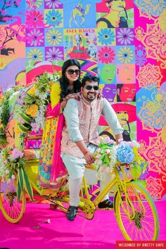Indian Wedding Mehendi Decor - Pop Inspired Decor | WedMeGood | Bride and Groom on a Floral Decorated Rickshaw with a Pop Inspired Michael Jackson Wall Indian Wedding Mehndi Décor in Destination Wedding in Rajasthan - #wedmegood #indianbride #indianwedding #color #popculture #colorfull #mehendidecor #mehndidecor #destinationwedding #desiwedding #pakistaniwedding #weddingdecor #indianweddingdecor #rickshaw @ @wedmegood via @sunjayjk