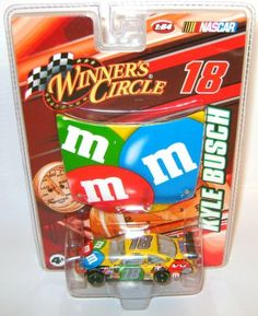 Kyle Busch #18 M & M Die Cast-1:64 scale Toyota Camry & 1:24 scale M Hood : Kyle Busch's M & M #18 - die cast of 1:64 scale Toyota Camry, made by Winner's Circle for NASCAR with a 1/24 M & M Hood in the blister pac.  This is a must have for the serious Kyle Busch fan and M & M collector.  Last one with    ...