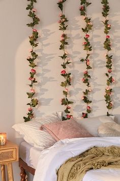 """Turn any space into a lush secret garden with this natural-looking faux vine featuring roses scattered along. Hang from the ceiling, wrap around columns and banisters or arrange with potted plants for a brilliantly blooming display. **Content + Care**   \- Plastic   \- Wipe clean   \- Imported   **Size**   \- Dimensions: 80""""l"""