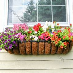 I just received this gorgeous French black wrought iron window box with coco liner  as a gift!  It's underneath a front window overlooking the driveway of my house so I'll see it every time I come home. Can't wait for spring to plant it full of flowers!