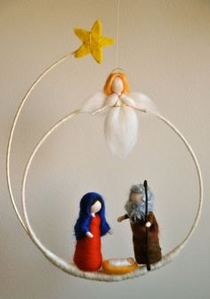This is a Waldorf inspired piece made of wool by the needle-felting technique. Its been created to provide a peaceful and harmonious image that communicates with the soul through its colors, textures, forms and energy. Dimensions: 4 in Marie , Joseph and the angel. Circle 19in hight,10in wide.