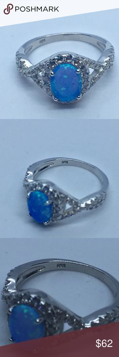🆕 925 Sterling Silver Lab Opal CZ Ring Stunning, 925 stamped sterling silver ring with light blue lab opal and CZ stones. The face height is 11 mm. Photos are zoomed in to show details! Please ask any questions! I always offer free shipping on sterling silver, either add to a Bundle and wait for me to send you a deal with free shipping, or send me an offer with at least $7 off asking price. Don't see your size? I can special order sizes, comment below! Jewelry Rings