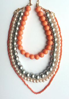Handmade necklace created with pink, coral and silver pearls.    www.facebook.com/SimplicitybyMelanie