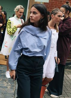 On the street at London Fashion Week. Photographed by Phil Oh.