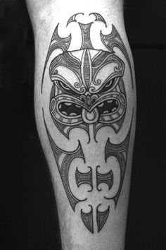 Another cool Tiki design for Ben's tattoo. This one is on a calf, (not an arm like Ben's), but I really love the Tiki in it.