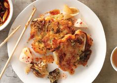 Kimchi Fritters with Soy Dipping Sauce Korean pickled cabbage, a. kimchi, provides the spice in these savory fritters, while soaked raw mung beans hold the flourless pancakes together. They're great with or without the dipping sauce and pickled pears. Sauce Recipes, Cooking Recipes, Kimchi Recipe, Fermented Foods, Fritters, Quesadillas, Bon Appetit, Asian Recipes, Food Inspiration