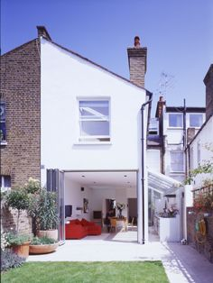 - Modern conversion and extension. (Rear view from garden) - patio glass extension lean-to terracotta