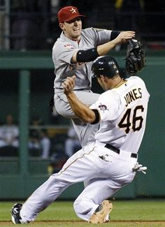 Houston Astros shortstop Jed Lowrie, top, relays the ball to first to complete a double play after forcing out Pittsburgh Pirates' Garrett Jones (46) at second on a ground ball by Neil Walker in the sixth inning of a baseball game, Monday, July 2, 2012, in Pittsburgh. The Pirates won 11-2. (AP Photo/Keith Srakocic)  game 80
