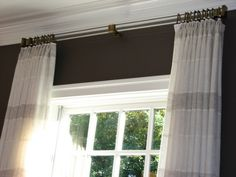 Rectangular acrylic with antiqued brass rings, brackets, and finials Available to the Trade