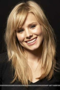 Thinking about getting my hair cut like this.. Long layers with side bangs