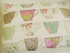 Laura Ashley embroidered tea cups cushion.