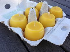 What we did with all those empty honeycombs: beeswax candles in our own eggshells!