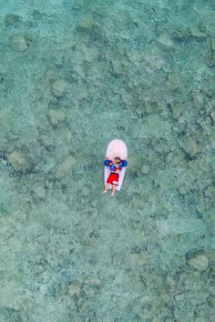 two year old on boggieboard drone i Hawaii Drone Family Photography