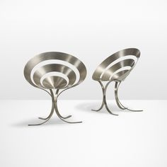 Lot 8: Maria Pergay. Important pair of Ring chairs. 1968, stainless steel. 28¾ w x 23 d x 32 h in. estimate: $50,000–70,000. This pair of Ring chairs is from the edition of approximately fifty. Provenance: Acquired directly from the Harvey Probber Showroom, New York circa 1970 by the present owner