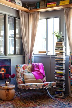 Need more room for your books and collectables? Use a book tower and add a shelf above your windows!