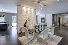 Modern Dining Room with Bubbles Lighting Collection, 3D Wall Cubes Wainscot Panels, High ceiling, travertine tile floors