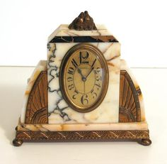 An Art Deco style marble and gilt metal mantle clock