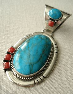 .turquoise and coral sterling silver pendant