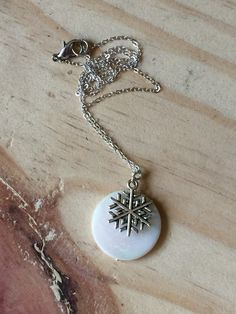A personal favorite from my Etsy shop https://www.etsy.com/listing/255398584/silver-snowflake-necklace-mother-of