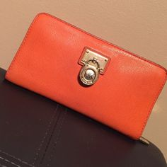 MK WALLET excellent used condition, no rips or tears. gold hardware (some scratches as photo shows). authentic. burnt orange color, not a bright shade at all. Michael Kors Bags Wallets