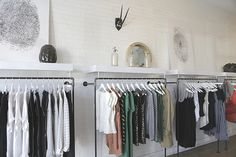 spaced out racks / white hangers / color blocked clothing sections