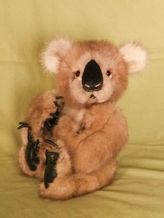 This is Orwa, a koala made from re-purposed mink, with leather paw pads, handmade clay claws, a handstitched nose, glass eyes and an open mouth with a faux suede tongue.  He is fully jointed and filled with fiber-fil, glass beads & love