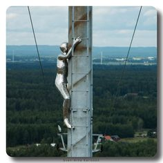 """Climbing """"Konst på hög"""" means something like """"Art on a Hill"""" or """"A pile of art"""" in English it is kind of a play upon words. It is an exhibition of sculptures on top of a 100 meter high artificial hill. It is located in Kumla Sweden only 10 minutes from where I live.  In the summer time you can drive your car and park on the top in winter time you have to walk to the top. """"Konst på Hög"""" has been open every summer since 1998 with new additions each year."""