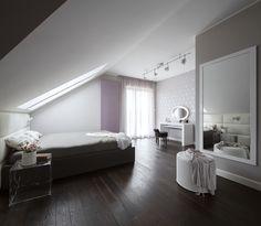 Colourful modern bedroom, bedroom in the attic, leather bed, leather bedhead, white bedhead, dark floor, violet bedroom, grey bedroom, grey wallpaper, modern wallpaper, big mirror, big mirror in bedroom
