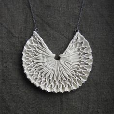 Textile necklace handmade from tinctory   like unglazed porcelain, the minimal colour brings shape and texture to the centre of attention    :: this textile necklace is made from off-white silk smocked with white cotton thread    :: the fabric part measures 8 cm (just over 3 inches) across