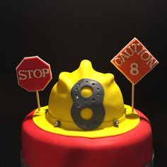 Hard hat and stop signs. All are hand made.