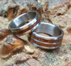 This matching ring set is simply beautiful, and this combination has been one of our best sellers. Each custom made ring is one of our hand milled and sized titanium rings. Weve given one of the bands two narrow manzanita wood inlays, and weve given the other a single, centered manzanita inlay. We love the clean, simple look of these wood inlay rings! These titanium and manzanita rings would make a stunning and unique non-traditional wedding band set. As always, this set is handmade by us…
