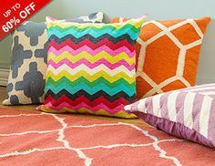 Our favorite patterned rugs, pillows, and poufs will brighten up any room in your home. Plush wool ottomans and colorful cushions make a splash in living areas, while stylish chevron rugs complement cozy kitchens and entryways. For an interesting, yet soothing, bedroom, stick with blue, green, and neutral shades.