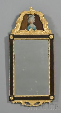 late 18th century Carved Gilt-gesso and Ebonized Looking Glass