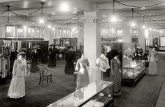 How fun to go back in time and shop in this department store...Mannequin fashion display C1910