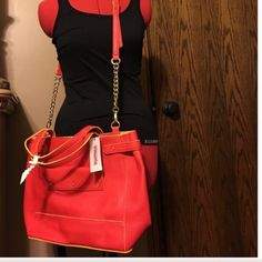 Trendy orange/red and yellow purse. NWT. This large purse boasts lot of room and style. It has an orange-y red color with yellow accents. Magnetic top closure. Has optional shoulder strap. Inside is one large opening. No zippers or pockets. Beautiful. JustFab Bags Totes