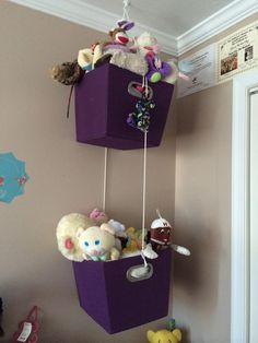 Have too many stuffed animals?  Hang baskets from ceiling for a neat way to hold and display them.
