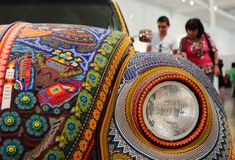 This awesome thing is a VW Beetle covered in traditional fabric and beadwork in Mexico...