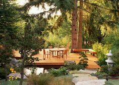 No rails - benches can add some protection on a low profile deck and seating area too.