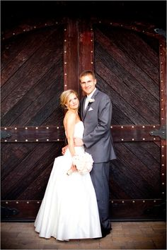 Bride and Groom outside our rustic wooden doors at the Palm Event Center in the Vineyard (photo by Julie Kay Kelly).