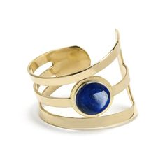 This bold asymmetrical cuff features a striking bezel set cabochon in lapis. Available in brass with sterling silver bezel and lapis cabochon.