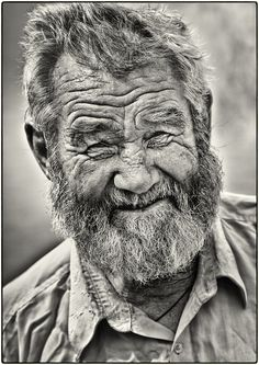 A life-story in a face, old man, powerful face, intense eyes, beard, wrinkles, lines of life, cracks in time, portrait, photo b/w.